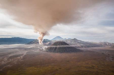 The eruption of mount Bromo darken the surrounding sky.
