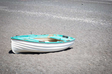 beached: A beached boat on the shore in the Sicilian town of Nizza di Sicilia.