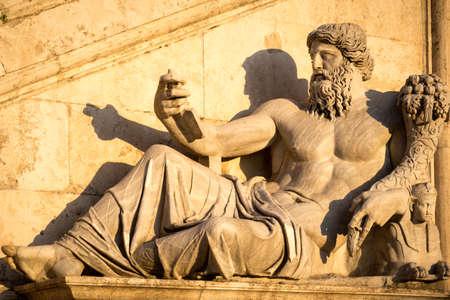 dea: A classical style sculpture at the Fontana della Dea Roma in Rome, Italy at dusk.