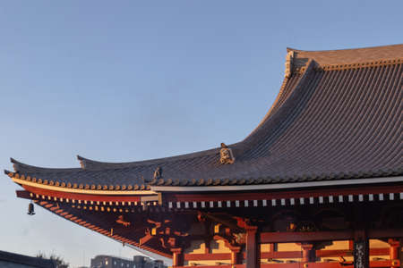 Detail of the roof of Asakusa Temple in Tokyo, Japan during dusk on a fall day.