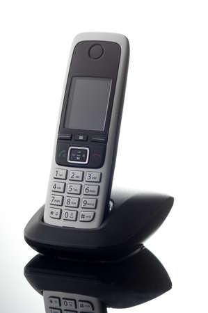 cordless: cordless telephone on white reflecting background