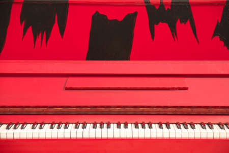 upright piano: The Red Upright Piano Stock Photo