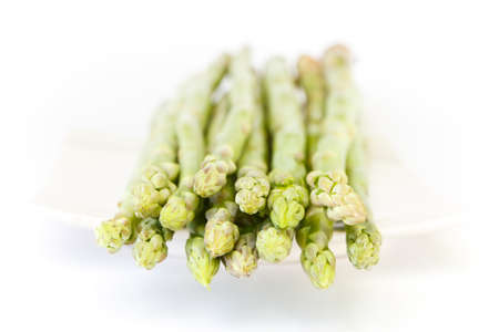 green fresh asparagus on white background photo