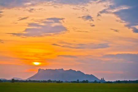 back farm rice sunset in Thailand , photo