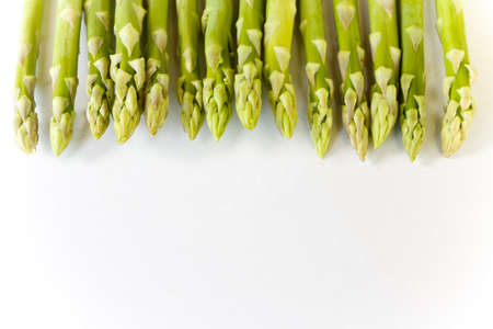 green fresh asparagus on white background