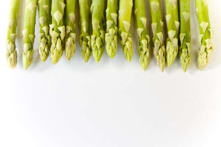 green fresh asparagus on white background