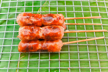Thai sausage inserts the wood in the market photo