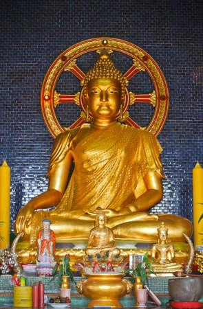Golden Buddha in Wat Tham Khaonoi, Chinese temple in Kanchanaburi province thailand photo