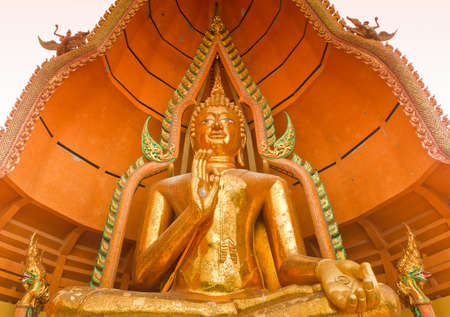 Big golden Buddha in Wat Tham Suea,Kanchanaburi photo