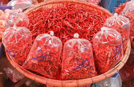 red dry chili solds in the market photo