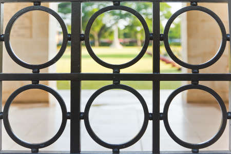 Wrought iron fence in a circle. Stock Photo