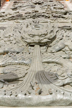 Carved stone dragons, in the Chinese temple thailand photo