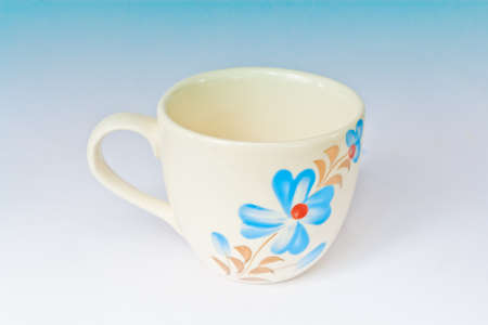 Colorful ceramic cup on a white screen  photo