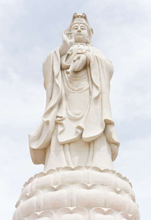 Kuan Yin statue made of marble, standing, in Thailand. Stock Photo