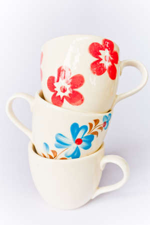 Colorful ceramic cup on a white screen.