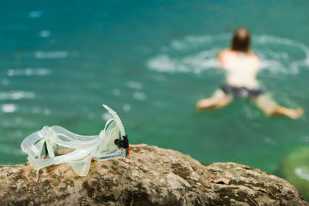 Snorkel, lay on the rocks, near waterfall Erawan.Kanchanaburi, Thailand. Stock Photo - 15309667
