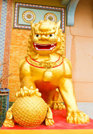 The golden lion statues in front of temple ,thailand Stock Photo