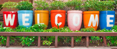 Welcome sign, at the flower pot. Stock Photo