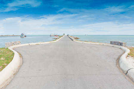 Fishing pier.at cha-am beach thailand Stock Photo - 15978118