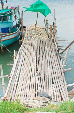 Fishing pier at cha-am beach thailand Stock Photo - 16654438