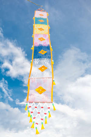 Flag of the Lanna Thai on blue sky at Chiang Mai top north Thailand  photo