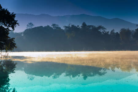 Morning lake, deep in the forest, Thailand  photo