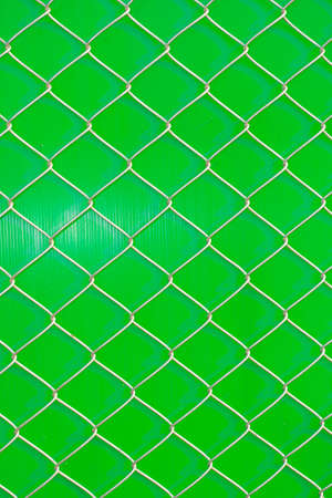 iron wire fence on green background
