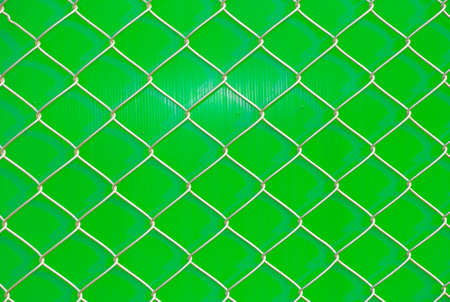 chain link fence: iron wire fence on green background