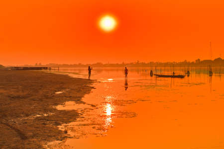 sunset, along the Mekong River, Thailand  photo