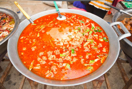 Curry chicken in a large pan, Thailand style photo