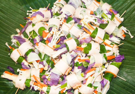 Bacon wrapped mushrooms and vegetables, then remove to fried or grilled, as snacks  Stock Photo