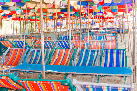 Beach umbrellas and chairs, colorful  photo