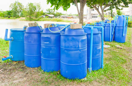 fermenters: Plastic tank for fermentation biogas. Stock Photo