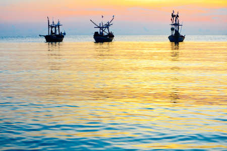 Hua -Hin sea and fishing boats, in the morning. photo