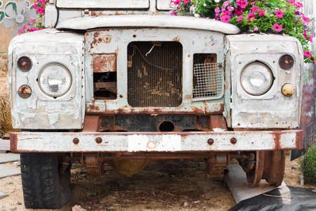 KANCHANABURI, THAILAND - JANUARY 9: Old classic car (Land Rover car, Old) decorated with flowers, watch for free, is open to public on January 9, 2015 at kanchanaburi, Thailand.