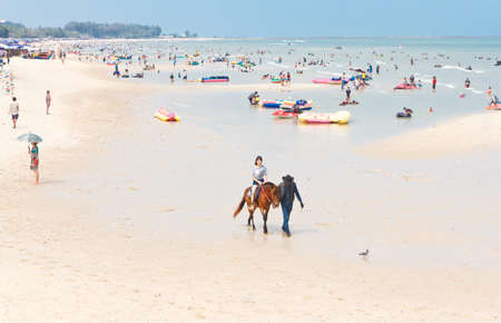 Phetchaburi, Thailand - March 22: Unidentified woman tourist, enjoy Activities, riding horses, on cha-am beach on March 22,2015 in Petchaburi Thailand. Editorial