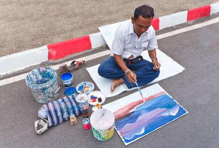 SATUN, THAILAND - MARCH 2: unidentified artist, drawing roadside. on walking street . on March 2,2013 Satun Thailand.