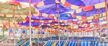 Beach umbrellas and chairs, colorful. Reklamní fotografie