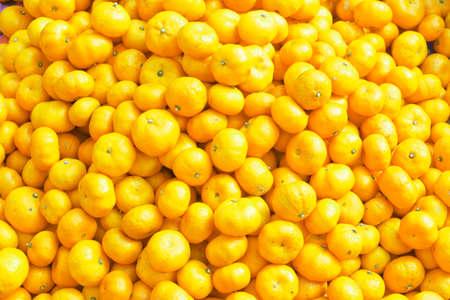 small orange mandarin (Clementine) on the market. Reklamní fotografie