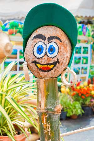 Cute Scarecrow, part head made of the pumpkin.