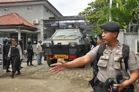 millitary: millitary vehicle on Dermaga Wijayapura,  police officer escort duo bali nine arrive on Dermaga Wijayapura Nusakambangan