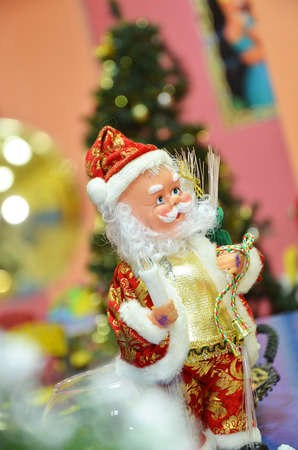new: appy Santa Claus Doll on Christmas time.colorful bokeh background. Stock Photo