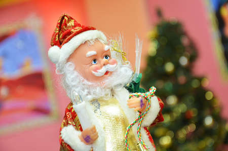 Santa claus puppet Christmas toy Santa Claus sits on a fir branch Stock Photo