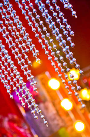 Bead curtain with cream-colored walls.(Selective focus) / diamond bead can be used as background or texture