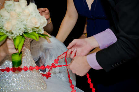 Close the ribbon on the belly of the bride. Womens fees on the wedding day.