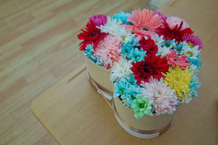 mixed marriage: Different flowers in many bright colors in a mixed heart bouquet