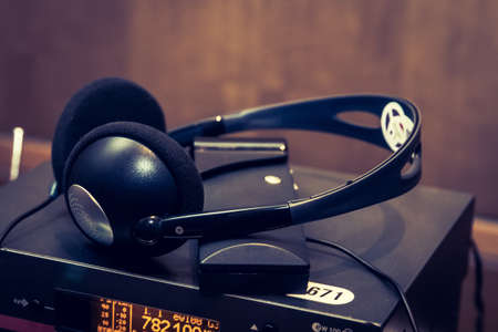headphones used for simultaneous translation equipment simultaneous interpretation equipment wireless multi language headphones set on the chairs in conference room. Monochromatic 写真素材