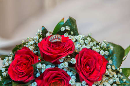 Rings on the red rose bouquet at the wedding . Wedding Ring in Rose, Will you marry me