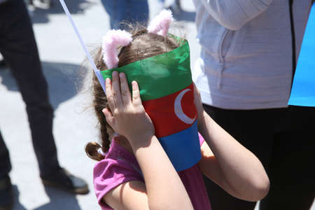 Azerbaijan flag in Baku, Azerbaijan. National sign background. Red Green Blue flag. Azerbaijan national flag with Crescent moon. Azerbaijan tradition patriotic. Flags waving wind 写真素材