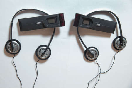 Headphones for simultaneous translation . wireless multy language headphones set on the chairs in conference room 写真素材